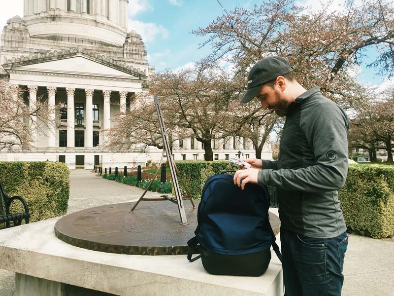 The model organizes his bag at the Olympia capitol